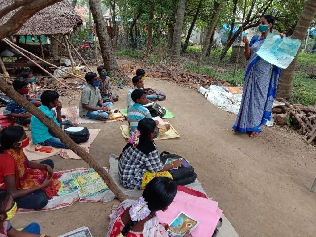 Mrs. Kavitha teaching her hope children