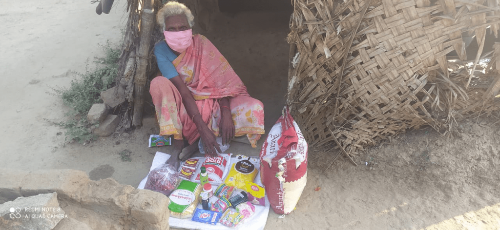 Ms. Pushpavalli in her house with a Hope for the Elderly rationing kit