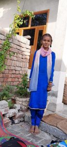 Picture of Rajja standing at her HLS.