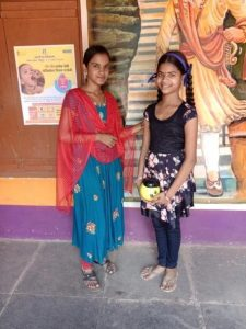 Ruchita with her Hope Learning Station teacher.