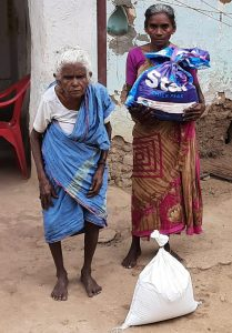 Periyakka and her daughter receiving Hope for the Elderly rationing kits.