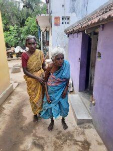 Periyakka's daughter helping Periyakka.