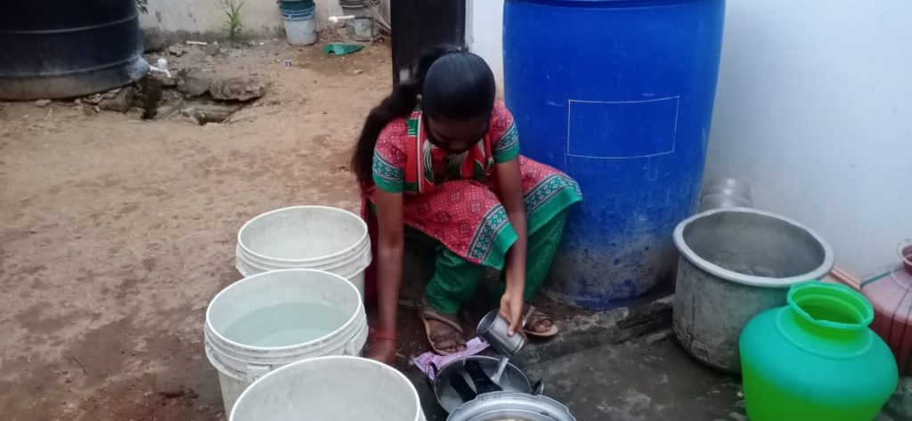 Hope Student Yazhini cleaning pots at her home.
