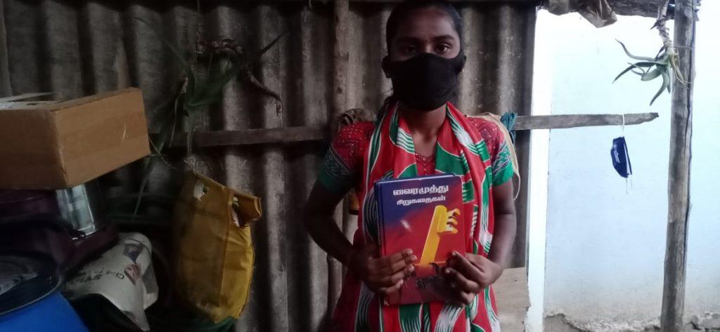 Hope Student Yazhini showing her literature books.