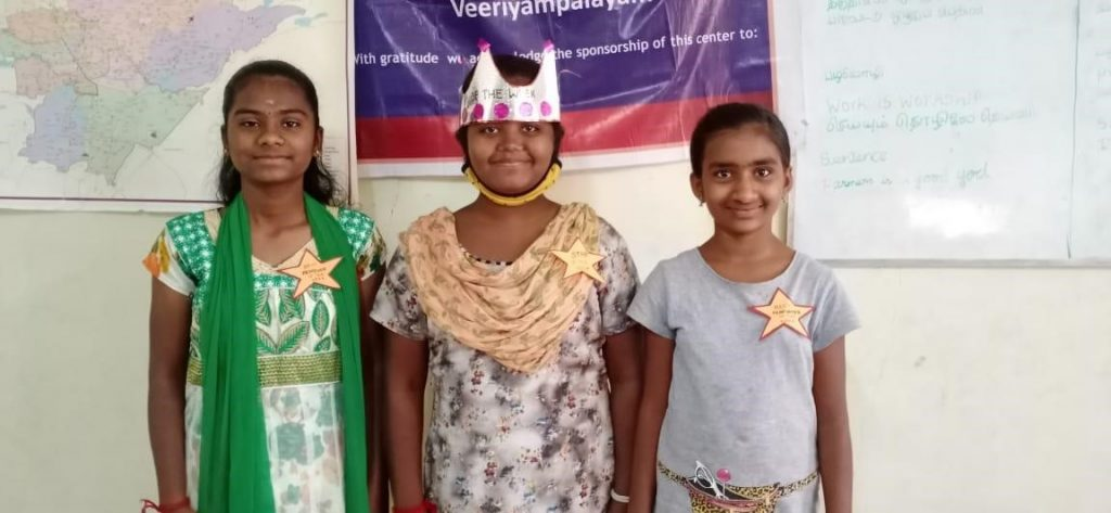 Hope Student Yazhini with her friends at the Hope Station.