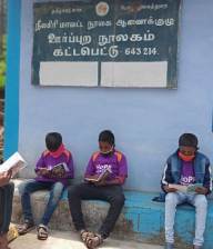 Hope students reading their books at the Hope Station