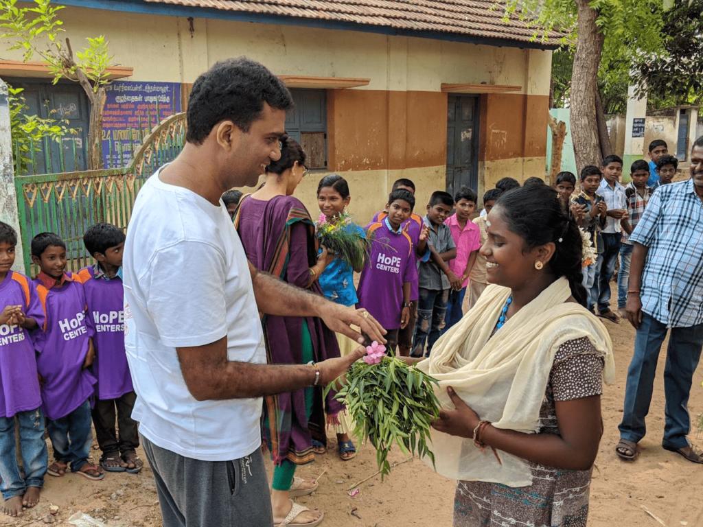 Hope Sponsor Krishna Bhaavin Shah giving gifts to Hope Children.