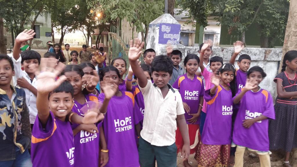 Hope Children waving goodbyes
