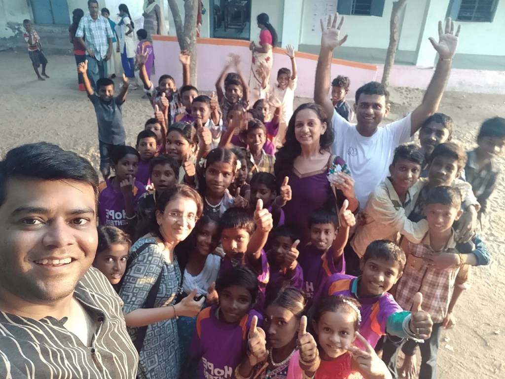 Hope Sponsor Krishna Bhaavin Shah taking a selfie with Hope Children at Hope Learning Stations